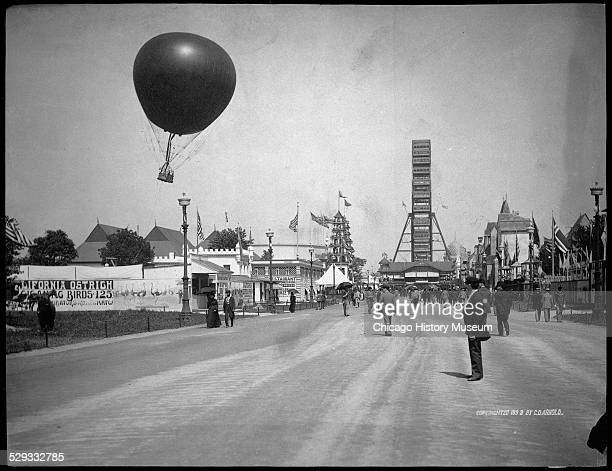 View of the Midway Plaisance at the World's Columbian Exposition world's fair Chicago Illinois 1893 View includes the Ferris Wheel and captive balloon