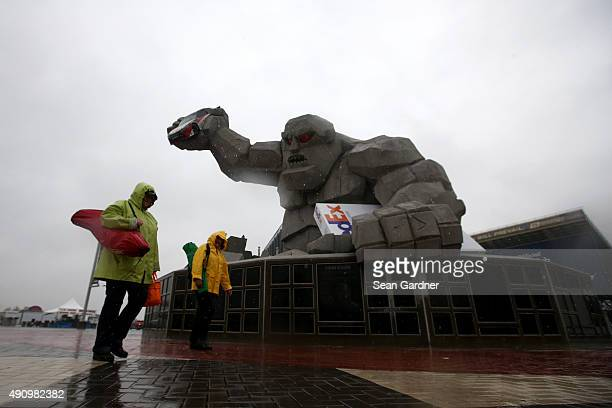 A view of the Miles The Monster statue in the rain outside the grandstands before practice for the NASCAR Sprint Cup Series AAA 400 at Dover...
