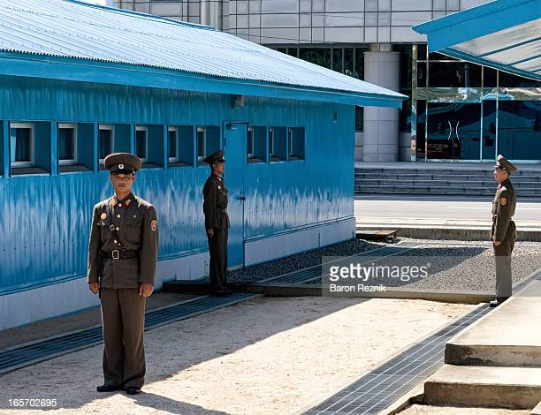 CONTENT] View of the Military Demarcation Line from inside the Join Security Area in Panmunjeom North Korea Korean People's Army soldiers stand guard...