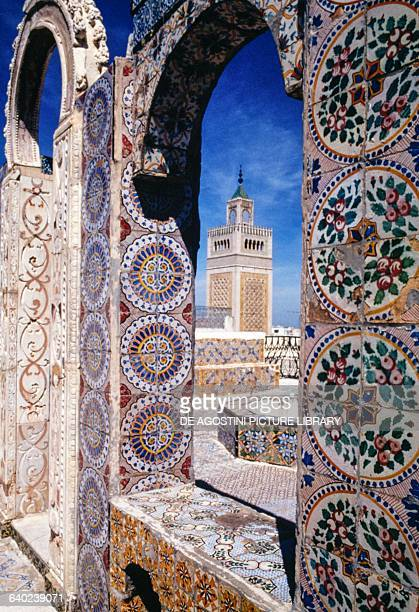 View of the minaret of Zaytuna mosque through an arch decorated with majolica tiles Tunis Tunis governorate Tunisia