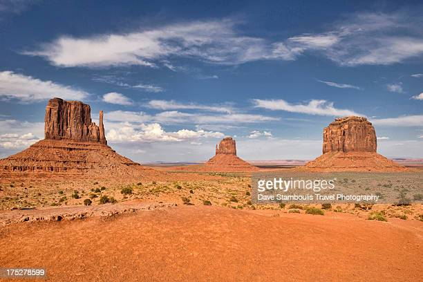 view of the mittens, monument valley, arizona-utah - arizona stock photos and pictures