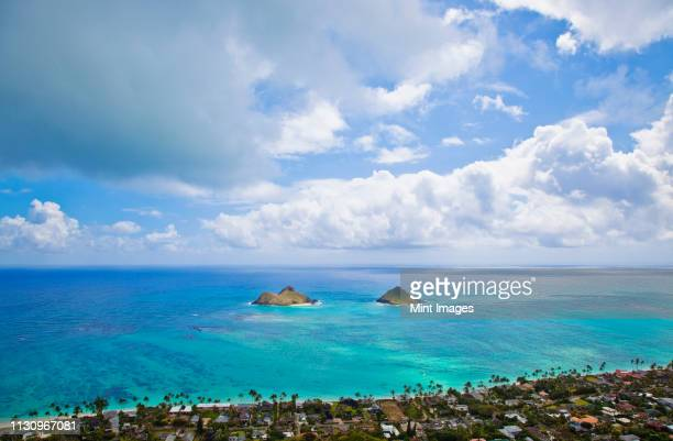 view of the mokulua islands - kailua stock pictures, royalty-free photos & images