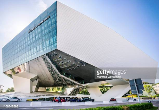 view of the monolithic, virtually floating exhibition hall of the porsche museum in stuttgart-zuffenheim, baden württemberg, germany, july 7, 2016 - stuttgart stock pictures, royalty-free photos & images
