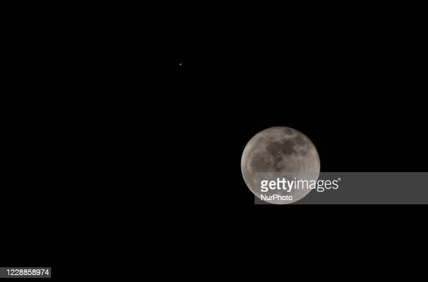 View of the moon alongside planet Mars, as seen from Bogota City on October 02, 2020.