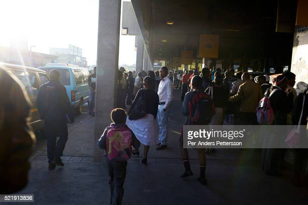 A view of the morning rush hour on May 2 2013 at Bara taxi station in Soweto South Africa This is Soweto's main taxi station and tens of thousands of...