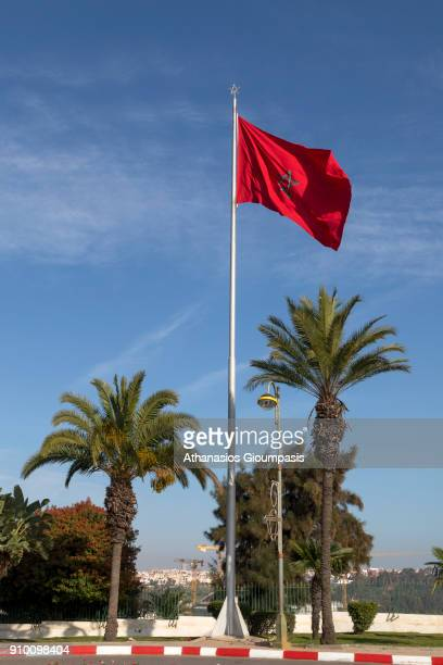 A view of the Moroccan national flag hoisted in a street near Hassan Tower on December 30 2017 in Rabat Morocco Moroccan flag represents hardiness...