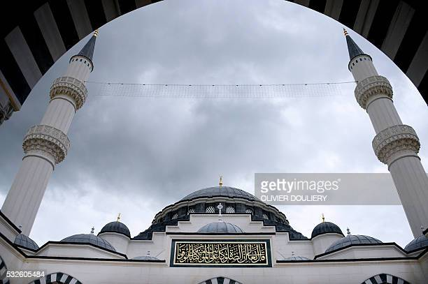 View of the mosque at the Diyanet Center of America on May 13 2016 in Lanham Maryland Sitting on a red and green carpet inside a mosque in a suburb...