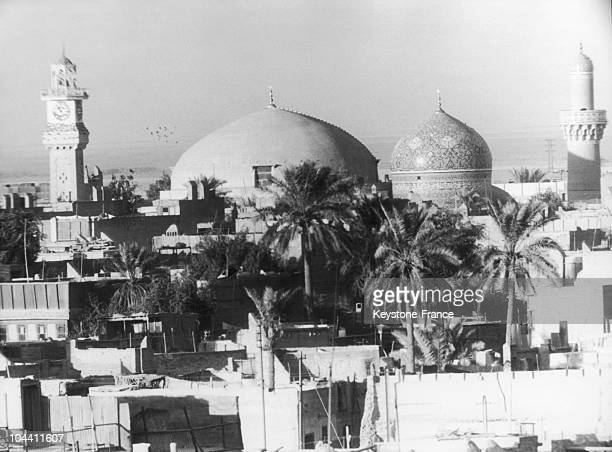 A view of the mosque of Sheikh Omar in Baghdad Iraq On the foreground the roofs of the Regent Park Hotel