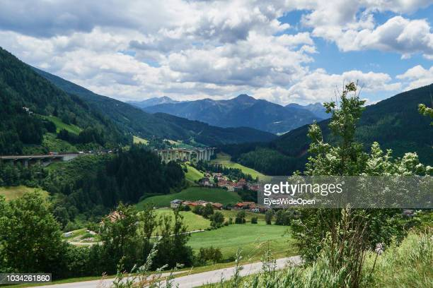 View of the mountains of South Tyrol next to the motorway bridge of the Brenner Highway on JUNE 27 2018 in Gossensass Italy