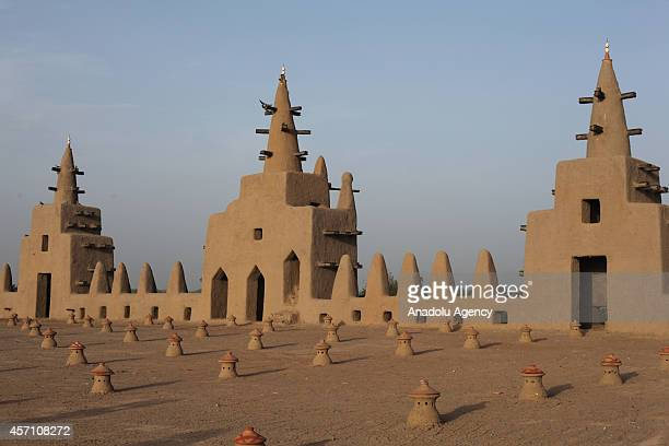 A view of the mud mosque and its minarets are seen in Djenne Mali on October 6 2014 The Great Mosque of Djenne is the largest mud brick building in...
