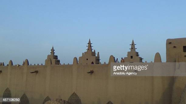 A view of the mud mosque's minarets are seen in Djenne Mali on October 6 2014 The Great Mosque of Djenne is the largest mud brick building in the...