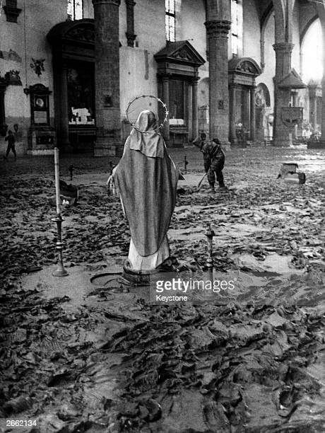 A view of the mudcovered interior of the Church of the Holy Cross in Florence after floods caused more than 57 million worth of damage in the city