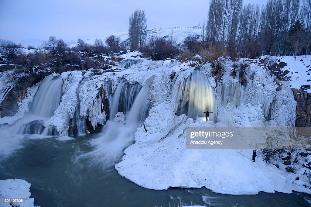 A view of the Muradiye Falls frozen over due to the extreme cold weather, in Van, Turkey on December 15, 2015.