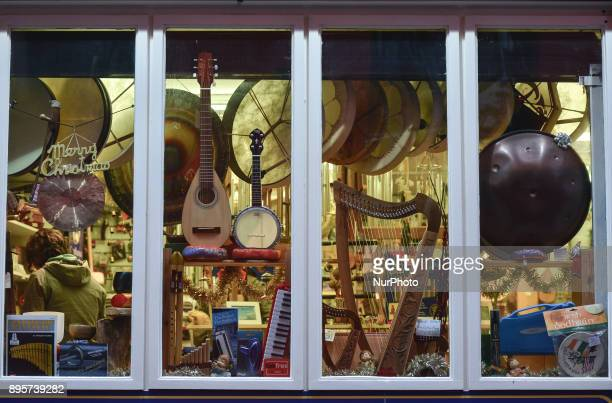 A view of the music instruments for sale in a shop in The Temple Bar during the Christmas Season 2017 just a few days ahead of Christmas On Tuesday...
