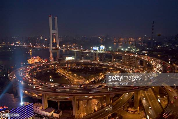 A view of the Nanpu Bridge at night When it opened in 1991 the Nanpu was the first bridge to span the Huang Pu river in Shanghai allowing for the...