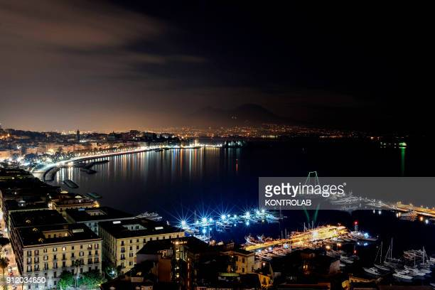 View of the Naples bay in the night in Campania Region Southern Italy
