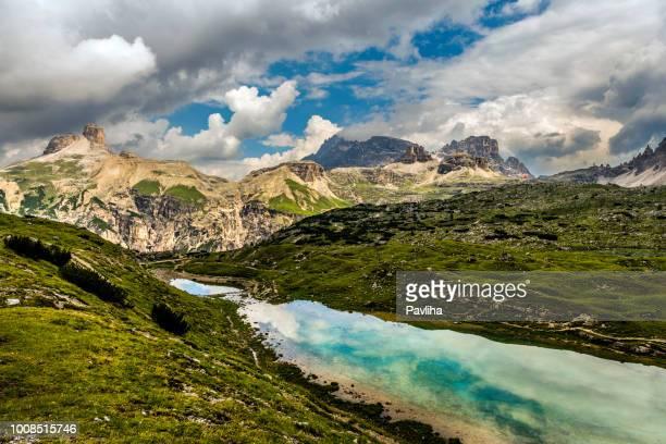 国立公園 tre cime di lavaredo、南チロルのビュー。場所アウロンツォ、劇的な曇り空、ドロミテ、ヨーロッパ アルプス、イタリア、ヨーロッパ - ベッルーノ ストックフォトと画像