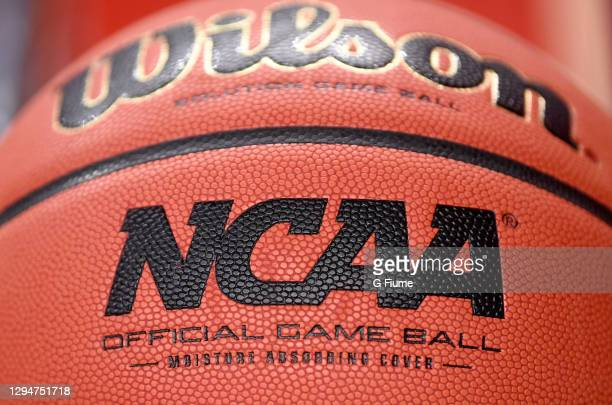 View of the NCAA logo on a basketball before the game between the Maryland Terrapins and the Michigan Wolverines at the Xfinity Center on December...