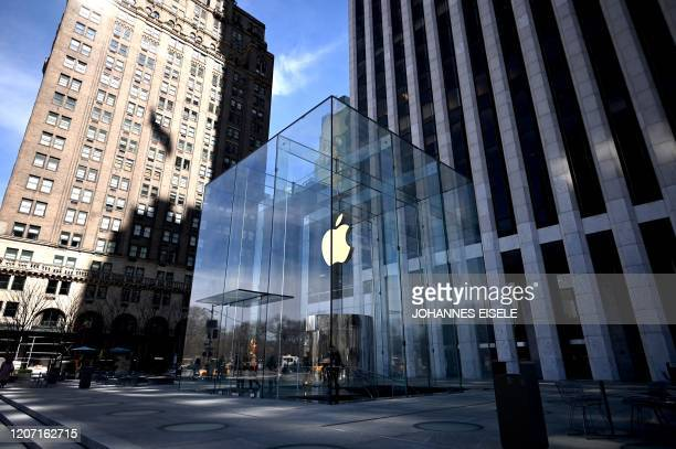 View of the nearly empty Apples flagship store on 5th Avenue in Manhattan on March 14, 2020 in New York City. - Apple closed all shops outside of...
