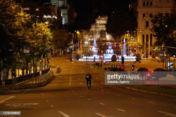 A view of the nearly empty Plaza de Cibeles after the Spanish premier declared a second state of emergency and enforce curfews in all regions except...