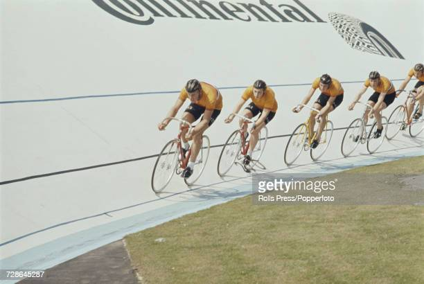 View of the Netherlands men's team pursuit team pictured in action together during competition in the Men's team pursuit event at the 1970 UCI Track...