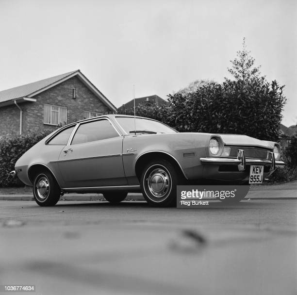 View of the new American built Ford Pinto two door saloon car parked on a residential street in England on 16th November 1970
