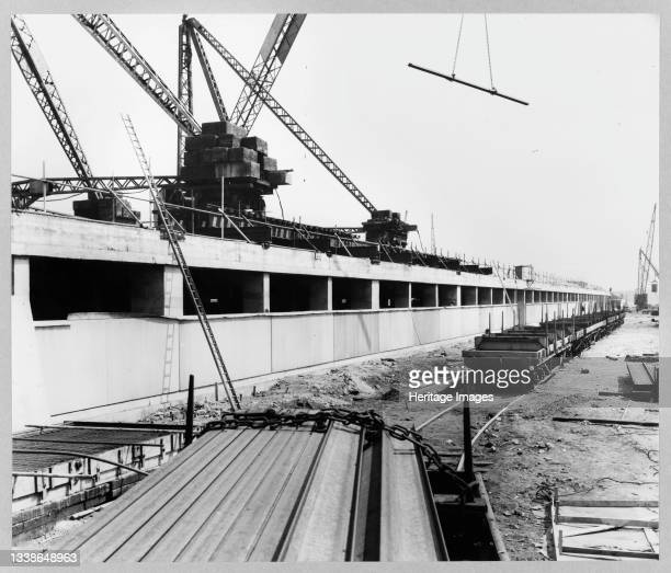 View of the new foundry under construction at the Ford Motor Company Works, showing cladding panels being erected on part of the south elevation, and...