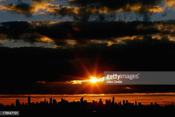A view of the New York City skyline is seen as the sun sets from Arthur Ashe Stadium on Day Nine of the 2013 US Open at the USTA Billie Jean King...