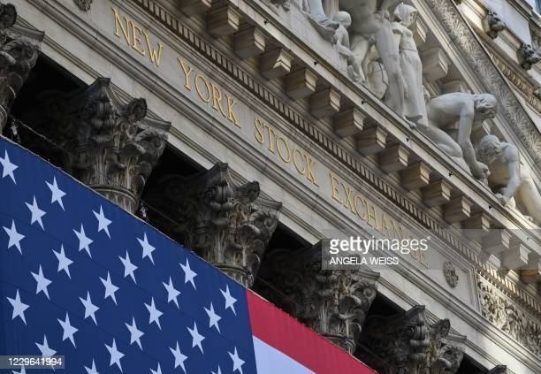View of the New York Stock Exchange at Wall Street on November 16, 2020 in New York City. - Wall Street stocks rose early following upbeat news on a...