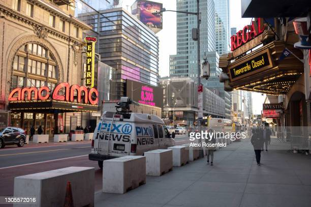 View of the newly reopened AMC Empire 25 opposite a Regal cinema which remains closed in Times Square on March 05, 2021 in New York City. Movie...