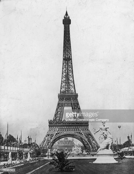 A view of the newlybuilt Eiffel Tower seen from the grounds of the Exposition Universelle or World Fair on the Champ de Mars in Paris