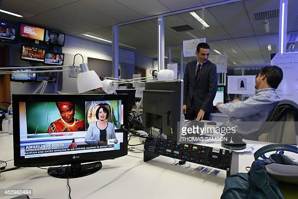 View of the newsroom at French TV channel France 24 headquarters in IssylesMoulineaux near Paris on September 23 2014 AFP PHOTO / THOMAS SAMSON