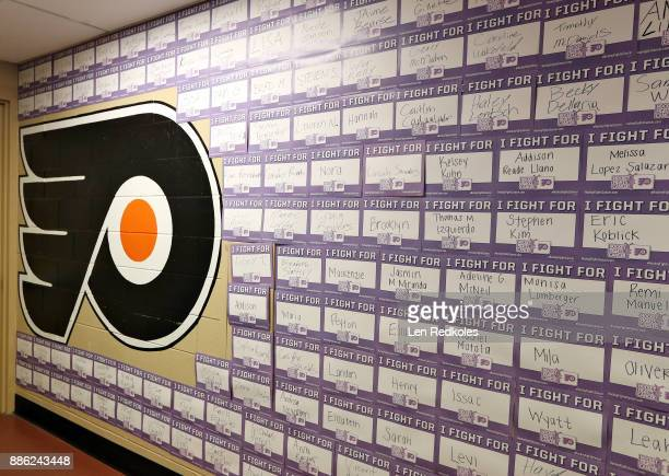 A view of the NHL u0093I fight for cancer placardsu0094 hung on the wall outside the locker room of the Philadelphia Flyers prior to a NHL game...