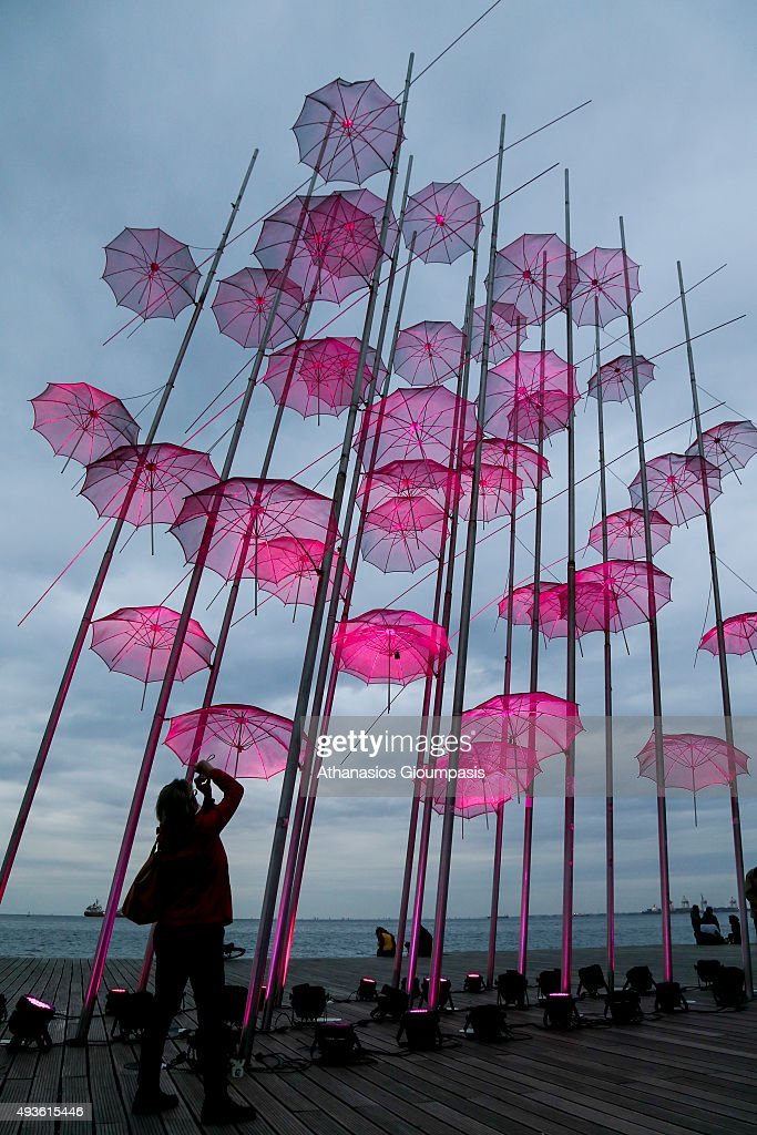 View of the Nikos Zoggolopoulos umbrellas with pink illumination as part of 'Pink October' in support for breat cancer campaign on October 21, 2015 in Thessaloniki, Greece. Nikos Zoggolopoulos umbrellas one of the most popular places illuminated pink to inform citizens and especially women about the prevention of Breast Cancer in the city many people rushed to be photographed .