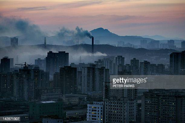 A view of the North Korean capital Pyongyang shows huge steam clouds from coal powered power plants 24 March 2005 South Korea confirmed 18 April 2005...