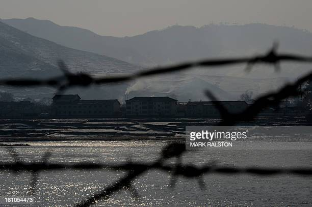 View of the North Korean town of Supung across the Yalu River from the Chinese town of Xiejiagou on February 9 2013 US Secretary of State John Kerry...