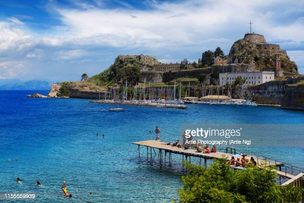 view of the northern side of the venetian old fortress (palaio frourio) and the great cross, corfu, ionian islands, greece - corfu stock pictures, royalty-free photos & images