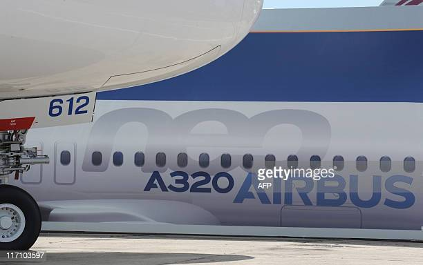 View of the nose of an Airbus A380 in front of one of the EADS Airbus site with an A320 Neo painted plane body at the Paris International Air Show on...