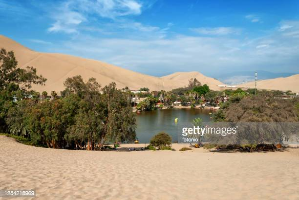 view of the oasis of huacachina from desert - dunes arena stock pictures, royalty-free photos & images