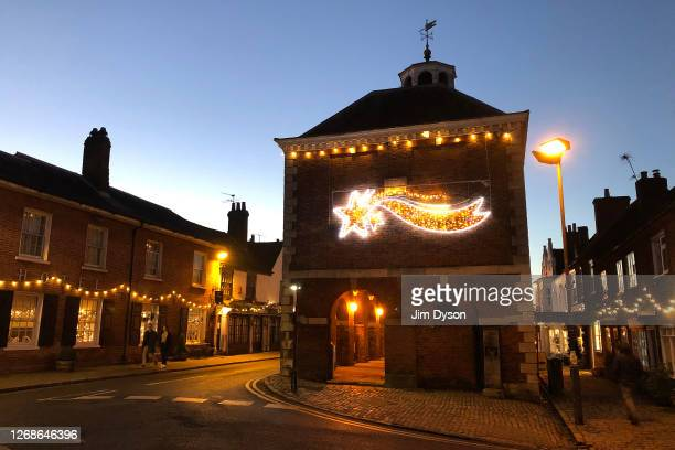 View of the Old Market Hall on the High Street in the Chilterns town of Old Amersham with Christmas decorations at sunset, on December 30, 2019 in...