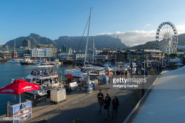 View of the Old Port Captain's Building clock tower and the Cape Wheel at the V A Waterfront in Cape Town South Africa with Table Mountain in the...