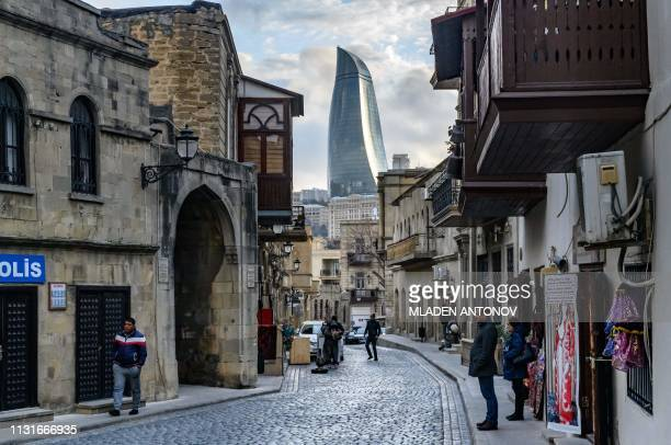 TOPSHOT A view of the Old town and the Flame Towers in Baku on March 18 2019