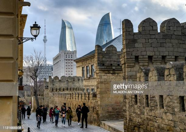 A view of the Old town and the Flame Towers in Baku on March 18 2019