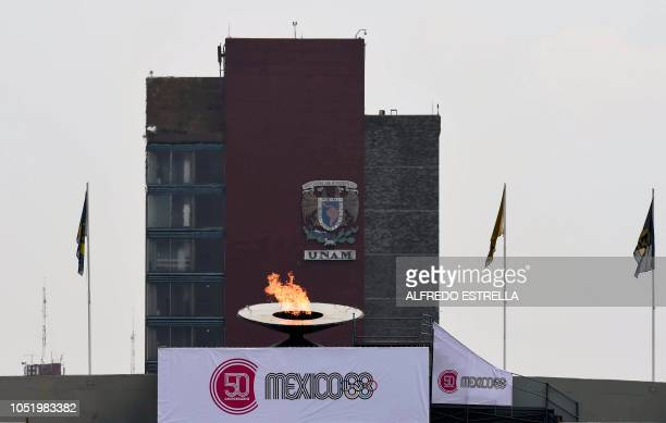 View of the Olympic cauldron during the ceremony to mark the 50th anniversary of Mexico's 1968 Summer Olympics at the Olimpico Universitario stadium...