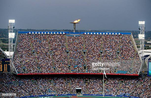 A view of the Olympic Flame and a capacity crowd inside the Olympic Stadium during the 2000 Summer Olympics