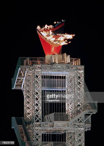 View of the Olympic flame lit by Muhammad Ali during the opening ceremony of the 1996 Olympic Games inside the Centennial Olympic Stadium in Atlanta...
