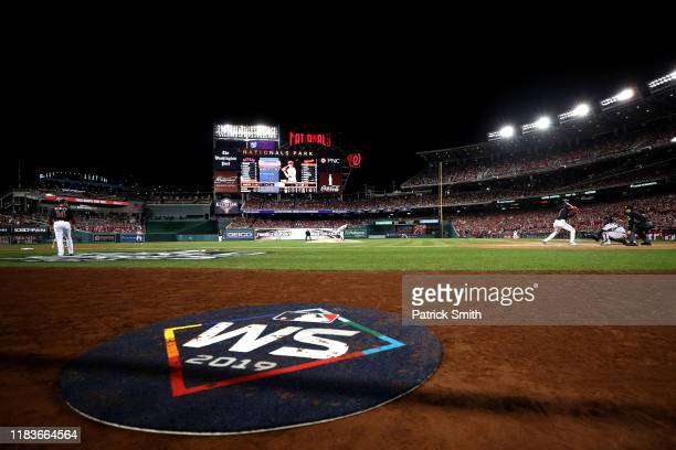 A view of the on deck circle featuring the World Series logo as Jose Urquidy of the Houston Astros pitches to Trea Turner of the Washington Nationals...