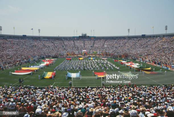 View of the opening ceremony of the 15th FIFA World Cup with spectators at the venue watching flags of the competing nations being held up on display...