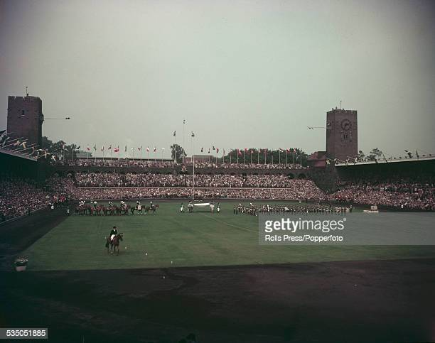 View of the opening ceremony of the Equestrian Olympics at the Stockholm Olympic Stadium in Sweden in June 1956. Equestrian events are being held in...