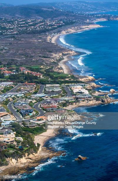 A view of the Orange County coastline looking from Corona del Mar toward Crystal Cove State Park during a new ecotour put on by IEX Helicopters out...